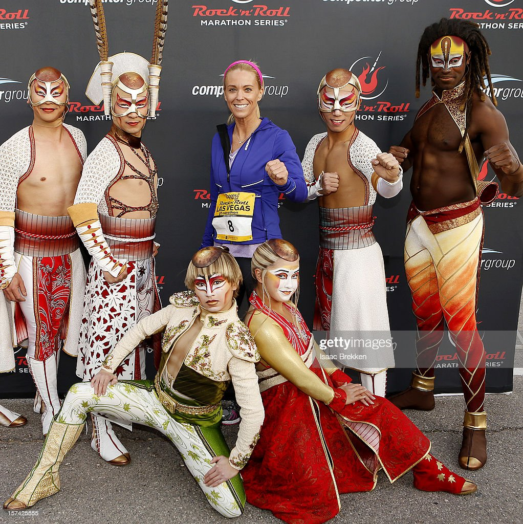 Television personality Kate Gosselin, flanked by performers from 'KA by Cirque du Soleil,' arrives at the Zappos.com Rock 'n' Roll Las Vegas Marathon on December 2, 2012 in Las Vegas, Nevada.