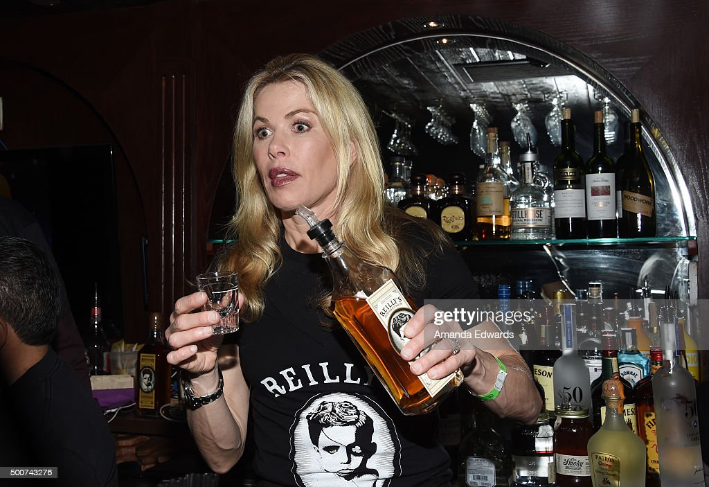Television personality Kathryn Edwards works behind the bar at Geoff Stults' birthday party fundraiser to benefit The Charlotte and Gwenyth Gray Foundation at Rock and Reilly's Irish Pub on December 9, 2015 in West Hollywood, California.