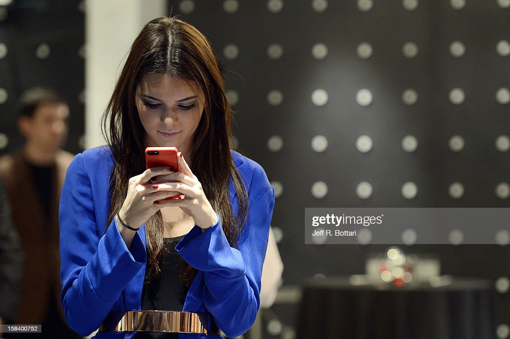 Television personality Kendall Jenner reviews pictures of the crowd on her phone during her appearance at the Kardashian Khaos store at The Mirage Hotel & Casino for a fan meet-n-greet on December 15, 2012 in Las Vegas, Nevada.
