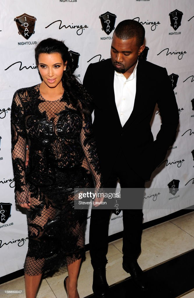 Television personality <a gi-track='captionPersonalityLinkClicked' href=/galleries/search?phrase=Kim+Kardashian&family=editorial&specificpeople=753387 ng-click='$event.stopPropagation()'>Kim Kardashian</a> and recording artist Kayne West arrive for a New Year's countdown at 1 OAK Las Vegas at The Mirage Hotel & Casino on December 31, 2012 in Las Vegas, Nevada.