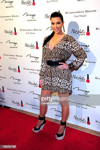 Television personality Kim Kardashian arrives at the grand opening of the Kardashian Khaos store at The Mirage Hotel Casino on December 15 2011 in...