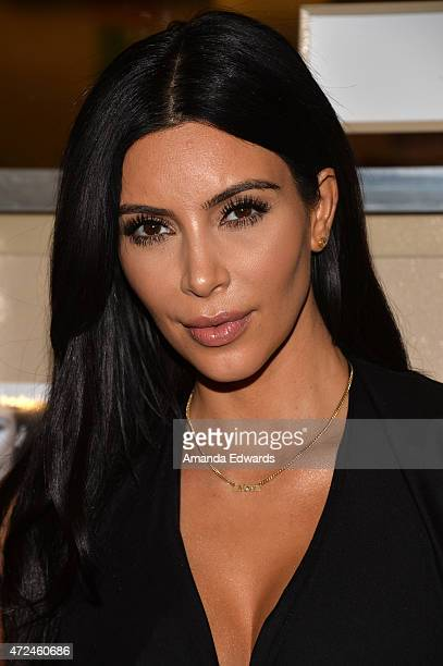 Television personality Kim Kardashian poses before signing copies of her book 'Selfish' at Barnes Noble bookstore at The Grove on May 7 2015 in Los...