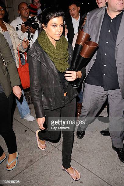 Television personality Kourtney Kardashian returns to her Downtown Manhattan hotel after getting a manicure and a pedicure at a nearby nail salon on...