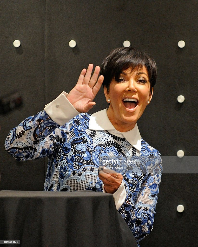 Television personality <a gi-track='captionPersonalityLinkClicked' href=/galleries/search?phrase=Kris+Jenner&family=editorial&specificpeople=762610 ng-click='$event.stopPropagation()'>Kris Jenner</a> (R) appears at the Kardashian Khaos store at The Mirage Hotel & Casino for a fan meet-and-greet on October 26, 2013 in Las Vegas, Nevada.