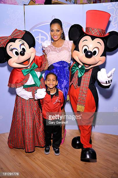 Television personality La La Anthony and son Kiyan Carmelo Anthony pose for pictures with Disney characters Minnie Mouse and Mickey Mouse at the...