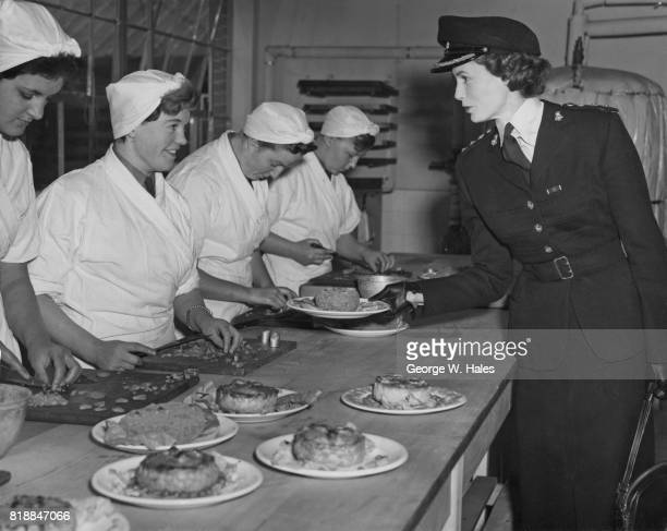 Television personality Lady Isobel Barnett inspects the dishes on offer at the WRAC Depot in Guildford Surrey in her role as Honorary Colonel of the...