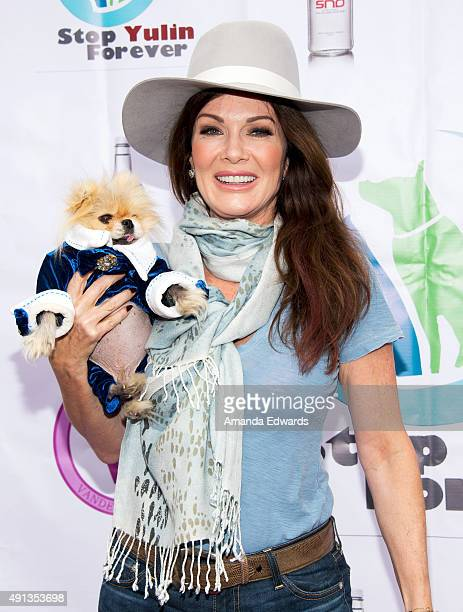 Television personality Lisa Vanderpump and Giggy attend the StopYulinForever March to End Dog Cruelty in Yulin China at MaCarthur Park Recreation...