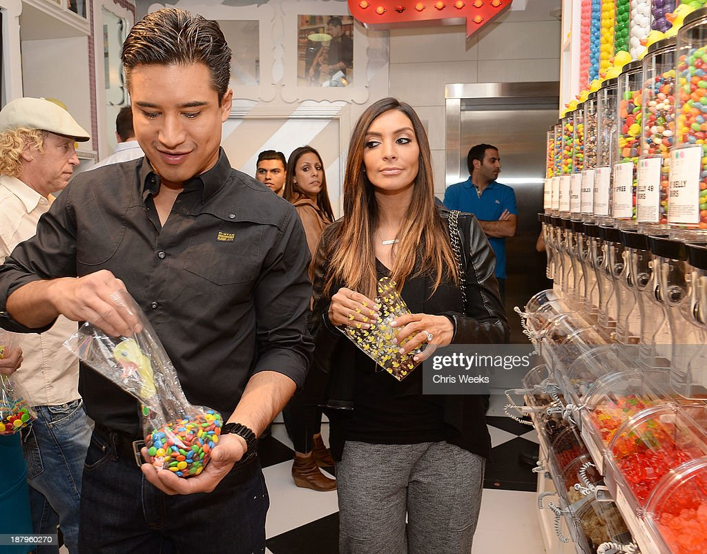 Television personality <a gi-track='captionPersonalityLinkClicked' href=/galleries/search?phrase=Mario+Lopez&family=editorial&specificpeople=235992 ng-click='$event.stopPropagation()'>Mario Lopez</a> and <a gi-track='captionPersonalityLinkClicked' href=/galleries/search?phrase=Courtney+Mazza&family=editorial&specificpeople=5650960 ng-click='$event.stopPropagation()'>Courtney Mazza</a> attend the grand opening of Sugar Factory Hollywood on November 13, 2013 in Hollywood, California.
