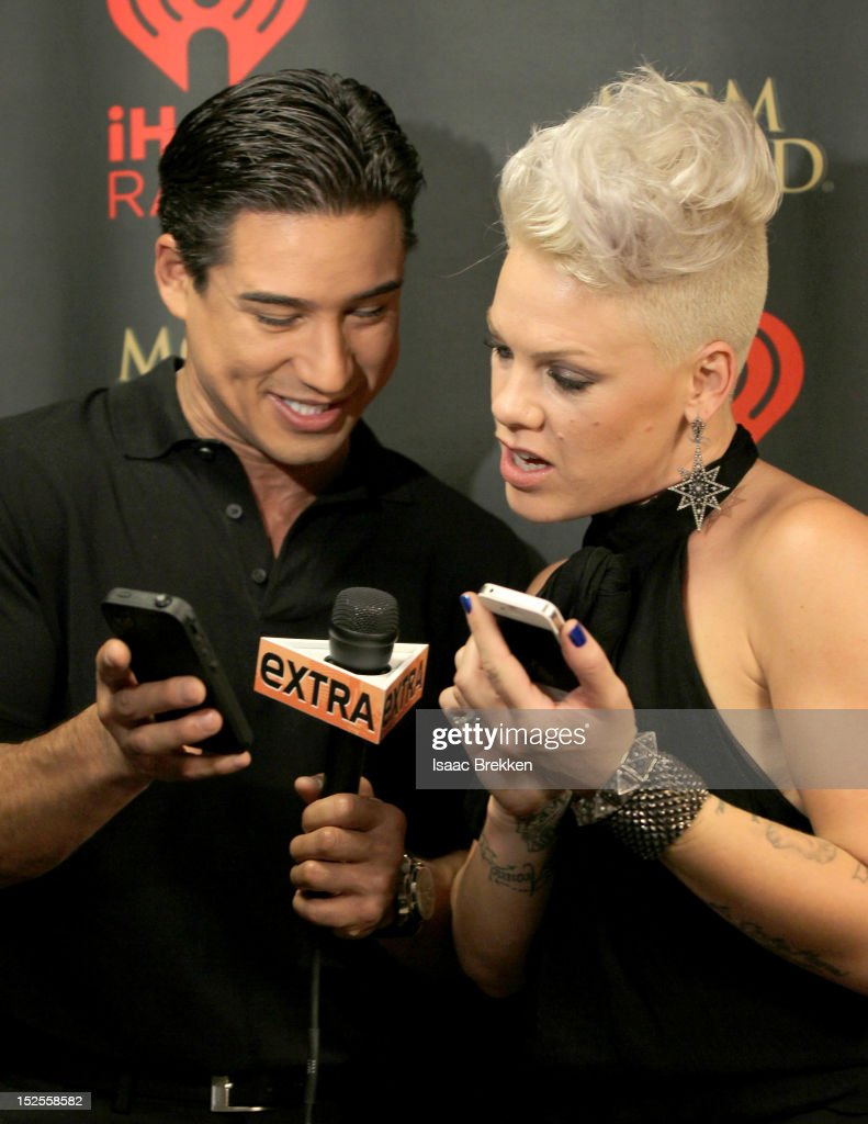 Television personality <a gi-track='captionPersonalityLinkClicked' href=/galleries/search?phrase=Mario+Lopez&family=editorial&specificpeople=235992 ng-click='$event.stopPropagation()'>Mario Lopez</a> (L) and singer <a gi-track='captionPersonalityLinkClicked' href=/galleries/search?phrase=Pink+-+Singer&family=editorial&specificpeople=220194 ng-click='$event.stopPropagation()'>Pink</a> appear backstage during the 2012 iHeartRadio Music Festival at the MGM Grand Garden Arena on September 21, 2012 in Las Vegas, Nevada.