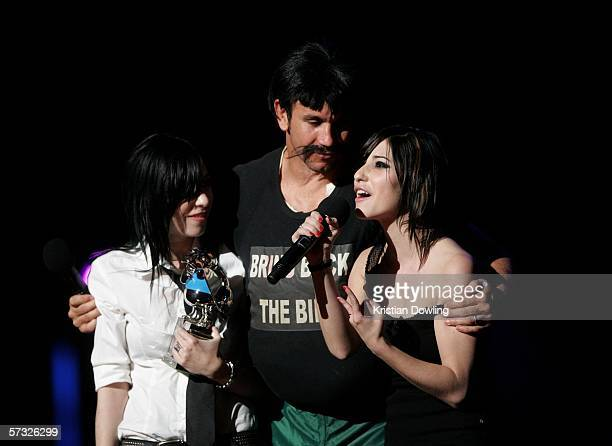 Television personality Matthew Johns as his alterego Reg Reagan presents the award for Spankin' New Aussie Artist to The Veronicas during the second...