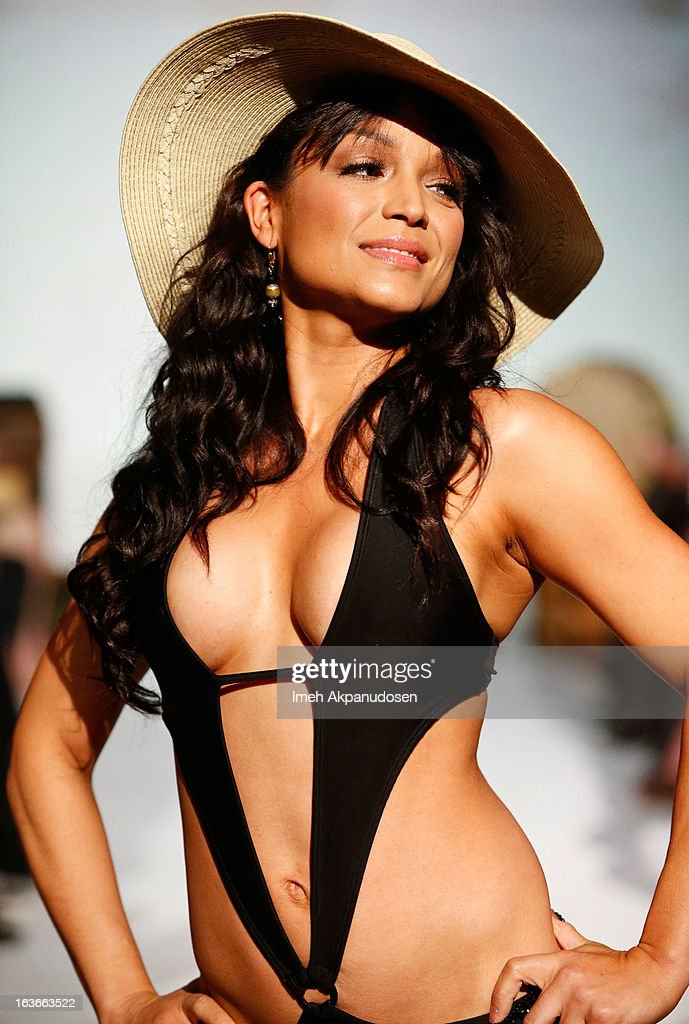 Television personality Mayte Garcia walks the runway showcasing designs by Sassi By Nancy E at the Spring 2013 Swimsuit Collection fashion show as part of Los Angeles Fashion Week at Stage 22 on March 13, 2013 in Los Angeles, California.