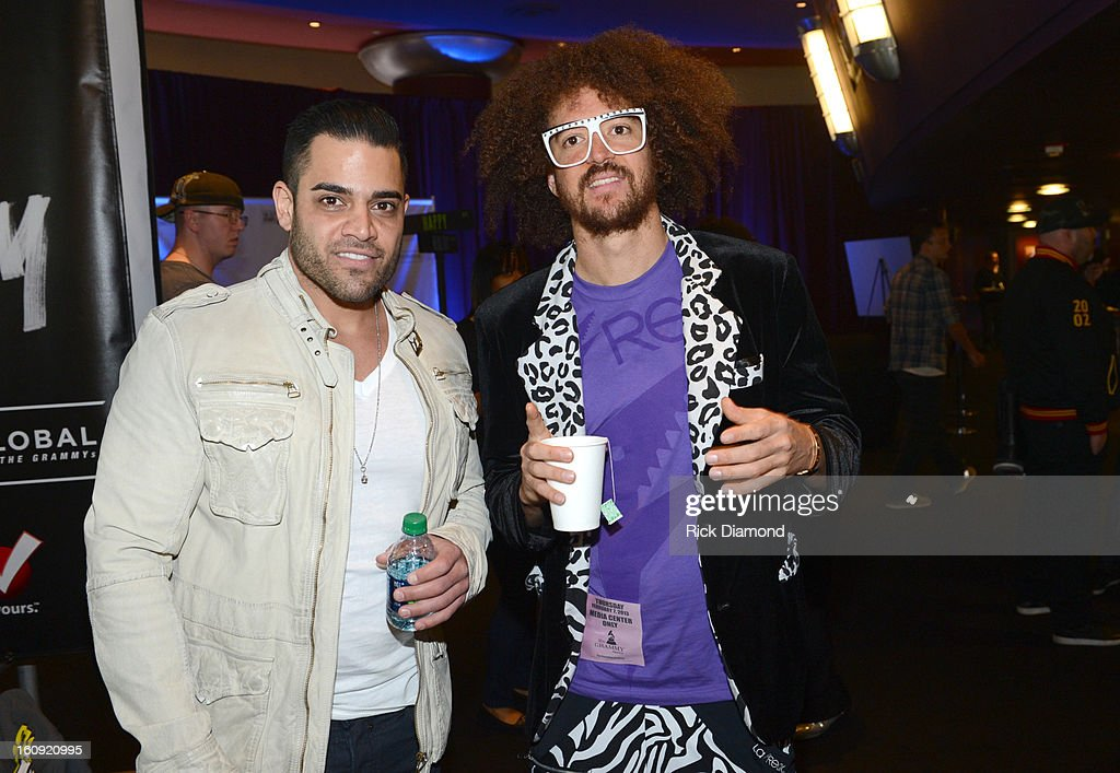 Television personality Mike Shouhed (L) and recording artist RedFoo backstage at the GRAMMYs Dial Global Radio Remotes during The 55th Annual GRAMMY Awards at the STAPLES Center on February 7, 2013 in Los Angeles, California.