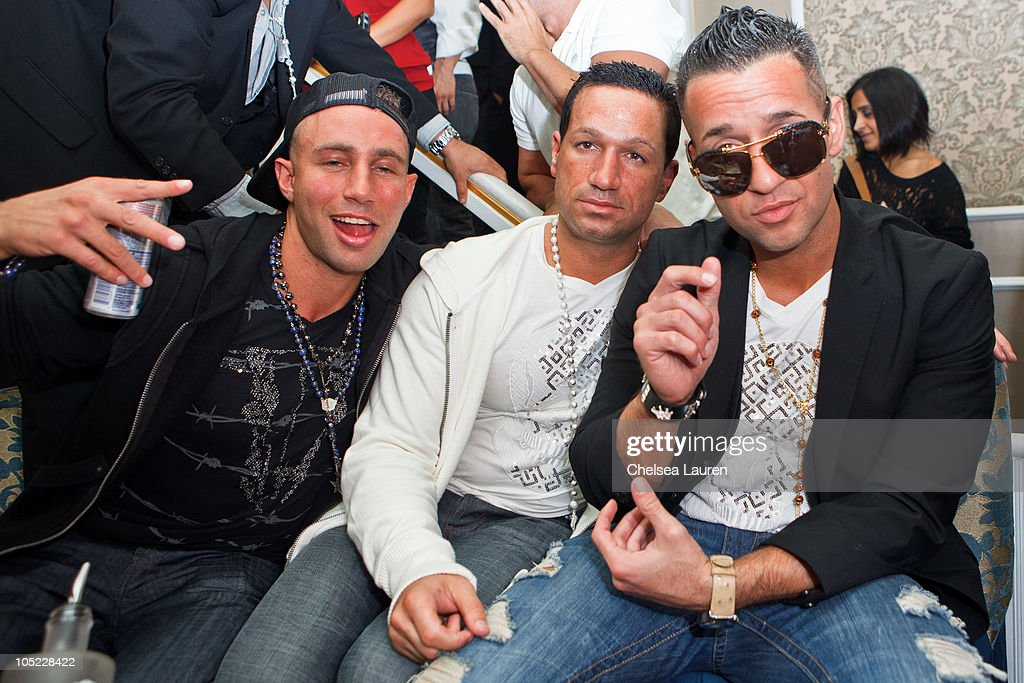 Television personality Mike 'the Situation' Sorrentino, brother Marc Sorrentino and friend Jonny 'the Unit' Manfre attend the Doctrine Denim launch party at Boudoir on October 12, 2010 in Los Angeles, California.