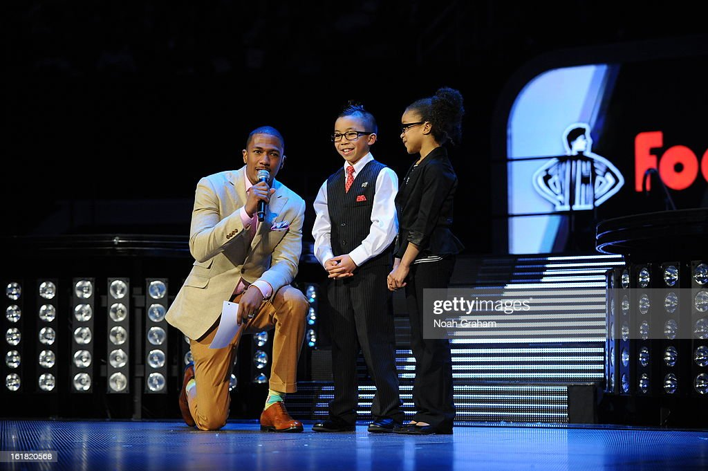 Television personality Nick Cannon interviews Kid Reporters Ryan and Jaylah during 2013 Foot Locker Three-Point Contest on State Farm All-Star Saturday Night as part of 2013 NBA All-Star Weekend on February 16, 2013 at Toyota Center in Houston, Texas.