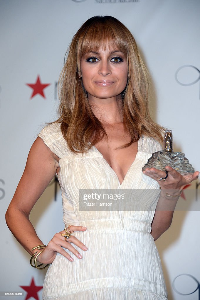 Television Personality <a gi-track='captionPersonalityLinkClicked' href=/galleries/search?phrase=Nicole+Richie&family=editorial&specificpeople=201646 ng-click='$event.stopPropagation()'>Nicole Richie</a> launches her new fragrance 'Nicole' at Macy's Glendale Galleria on August 29, 2012 in Glendale, California.