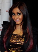 Television personality Nicole 'Snooki' Polizzi appears during an autograph signing at iHip's booth at the 2012 International Consumer Electronics...
