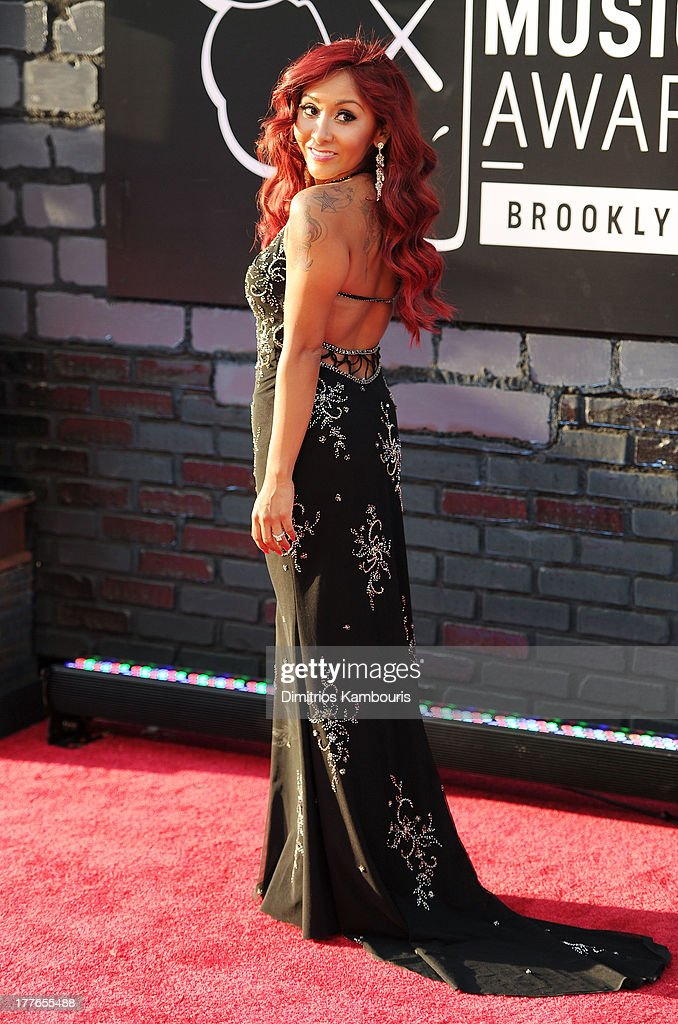 Television personality Nicole 'Snooki' Polizzi (Detail: NYC Glitz dress) attends the 2013 MTV Video Music Awards at the Barclays Center on August 25, 2013 in the Brooklyn borough of New York City.