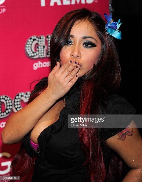 Television personality Nicole 'Snooki' Polizzi blows a kiss as she arrives at the Ghostbar Dayclub's New Year's Eve party at the Palms Casino Resort...
