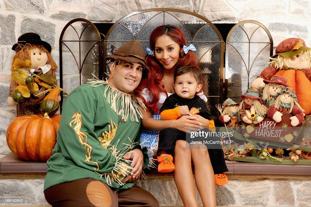 Television personality Nicole 'Snooki' Polizzi, Jionni Lavalle and their son Lorenzo Lavalle celebrate Halloween in their costumes from Rubies Costume Company on October 24, 2013 in Whippany, New Jersey.