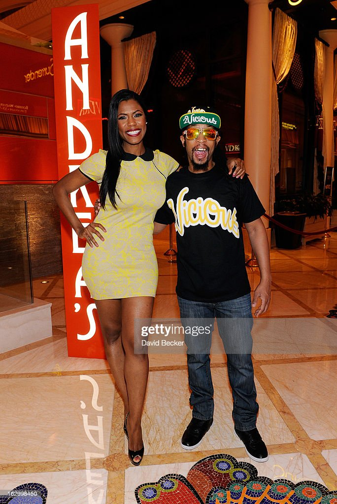 Television personality Omarosa Manigault (L) and recording artist Lil' Jon arrive at Andrea's at Encore Las Vegas to celebrate the season premiere of 'All-Star Celebrity Apprentice' on March 2, 2013 in Las Vegas, Nevada.