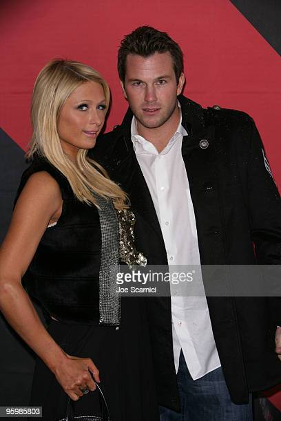 Television personality Paris Hilton and Doug Reinhardt pose at the 'Teenage Paparazzo' premiere during the 2010 Sundance Film Festival at Racquet...