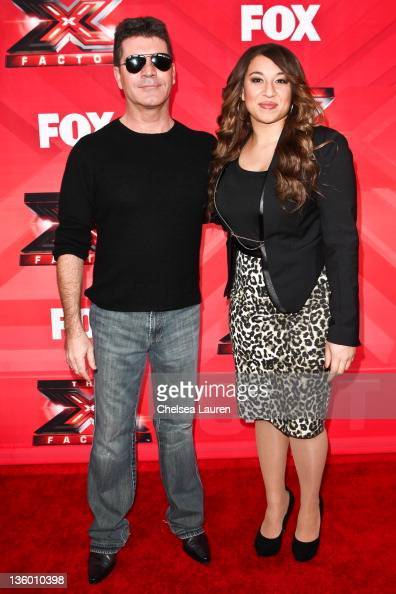 Television personality / producer Simon Cowell and singer / finalist Melanie Amaro arrive at 'The X Factor' press conference at CBS Television City...