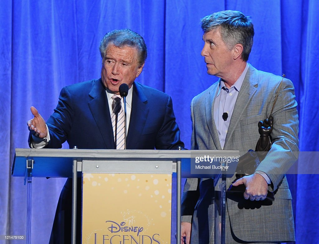 Television personality <a gi-track='captionPersonalityLinkClicked' href=/galleries/search?phrase=Regis+Philbin&family=editorial&specificpeople=202495 ng-click='$event.stopPropagation()'>Regis Philbin</a> (L) speaks with <a gi-track='captionPersonalityLinkClicked' href=/galleries/search?phrase=Tom+Bergeron&family=editorial&specificpeople=663624 ng-click='$event.stopPropagation()'>Tom Bergeron</a> after being inducted to the Disney Legends during the D23 Expo 2011 at the Anaheim Convention Center on August 19, 2011 in Anaheim, California.