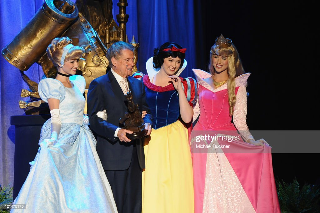 Television personality <a gi-track='captionPersonalityLinkClicked' href=/galleries/search?phrase=Regis+Philbin&family=editorial&specificpeople=202495 ng-click='$event.stopPropagation()'>Regis Philbin</a> stands with Disney Princesses at the Disney Legends Awards Ceremony during the D23 Expo 2011 at the Anaheim Convention Center on August 19, 2011 in Anaheim, California.