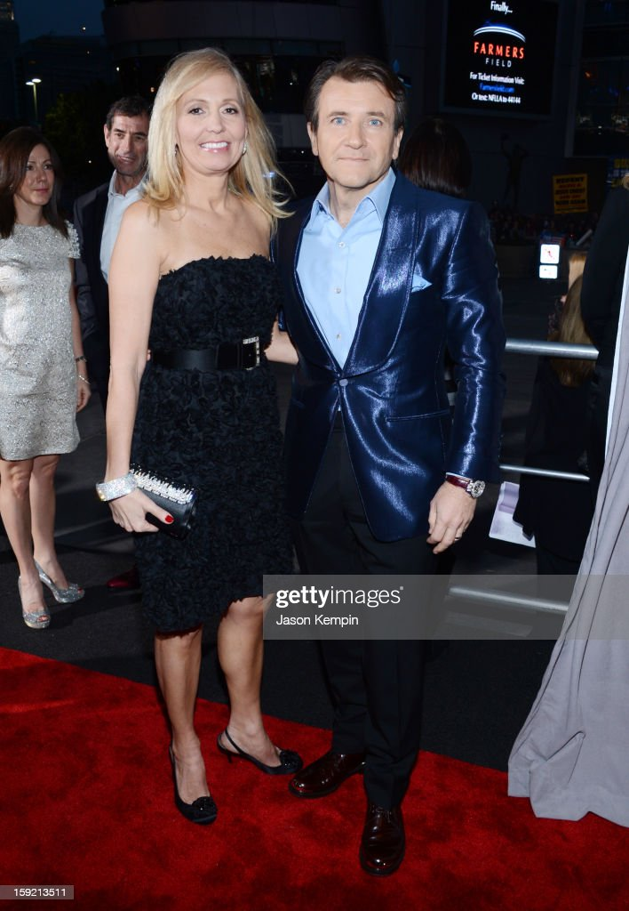 Television personality <a gi-track='captionPersonalityLinkClicked' href=/galleries/search?phrase=Robert+Herjavec&family=editorial&specificpeople=6129084 ng-click='$event.stopPropagation()'>Robert Herjavec</a> and wife attend the 39th Annual People's Choice Awards at Nokia Theatre L.A. Live on January 9, 2013 in Los Angeles, California.