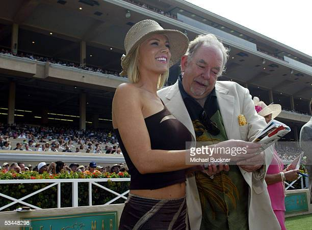 Television personality Robin Leach and Denise Pressley watch Leach's horse She's a Jewel win a race at the $1000 Pacific Classic at the Del Mar...