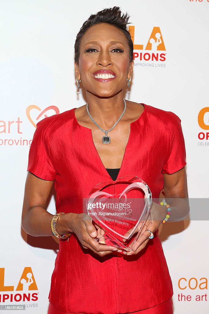 Television personality <a gi-track='captionPersonalityLinkClicked' href=/galleries/search?phrase=Robin+Roberts+-+Television+Anchor&family=editorial&specificpeople=4439371 ng-click='$event.stopPropagation()'>Robin Roberts</a> attends CoachArt's 9th Annual 'Gala Of Champions' at The Beverly Hilton Hotel on October 17, 2013 in Beverly Hills, California.