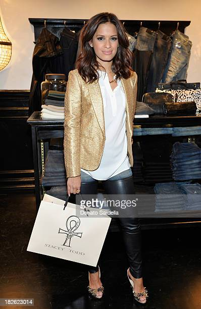 Television personality Rocsi Diaz attends the opening of Stacey Todd West Hollywood with Stacey Todd and rag bone at Stacey Todd on October 1 2013 in...