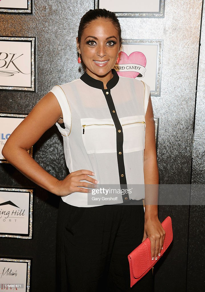Television personality Sammi Giancola poses at the GBK & Sparkling Resort Fashionable Lounge during Mercedes-Benz Fashion Week on September 6, 2013 in New York City.