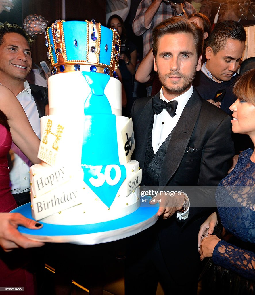 Television personality <a gi-track='captionPersonalityLinkClicked' href=/galleries/search?phrase=Scott+Disick&family=editorial&specificpeople=4420046 ng-click='$event.stopPropagation()'>Scott Disick</a> holds his birthday cake as he celebrates his 30th birthday at Hyde Bellagio at the Bellagio over Memorial Day weekend on May 26, 2013 in Las Vegas, Nevada.
