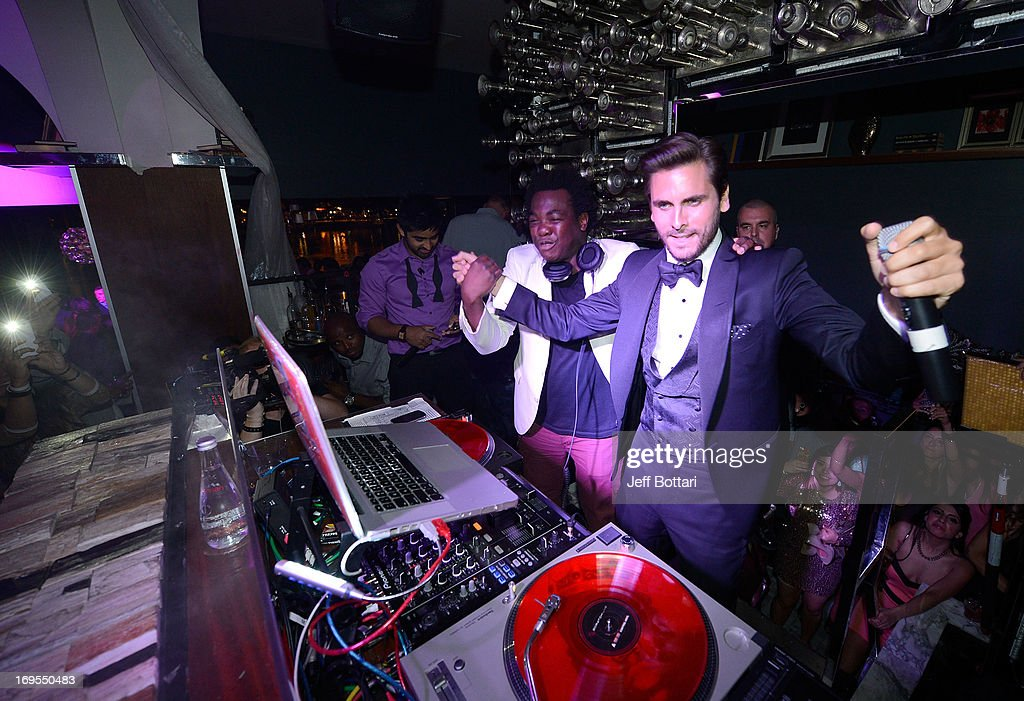 Television personality <a gi-track='captionPersonalityLinkClicked' href=/galleries/search?phrase=Scott+Disick&family=editorial&specificpeople=4420046 ng-click='$event.stopPropagation()'>Scott Disick</a> (R) performs with DJ Reach as he celebrates his 30th birthday at Hyde Bellagio at the Bellagio over Memorial Day weekend on May 26, 2013 in Las Vegas, Nevada.