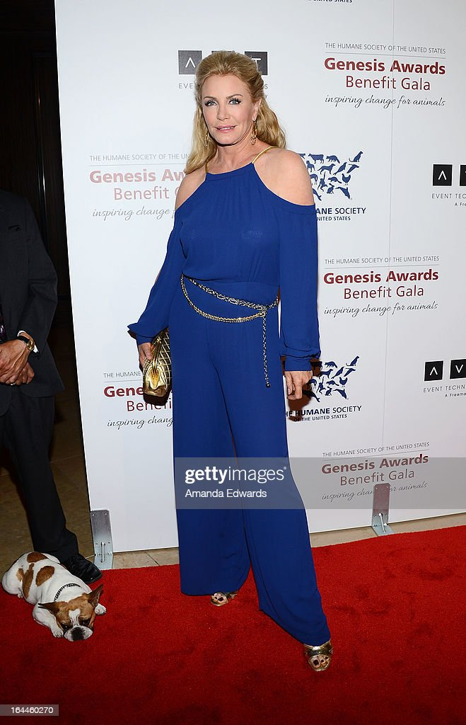Television personality Shannon Tweed and Beatrice the dog arrive at The Humane Society's 2013 Genesis Awards Benefit Gala at The Beverly Hilton Hotel on March 23, 2013 in Beverly Hills, California.