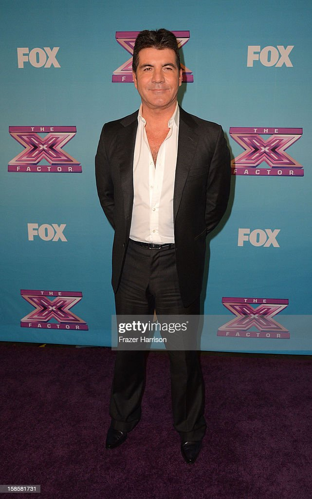 Television personality <a gi-track='captionPersonalityLinkClicked' href=/galleries/search?phrase=Simon+Cowell&family=editorial&specificpeople=203007 ng-click='$event.stopPropagation()'>Simon Cowell</a> arrives at Fox's 'The X Factor' Season Finale Night 1 at CBS Television City on December 19, 2012 in Los Angeles, California.