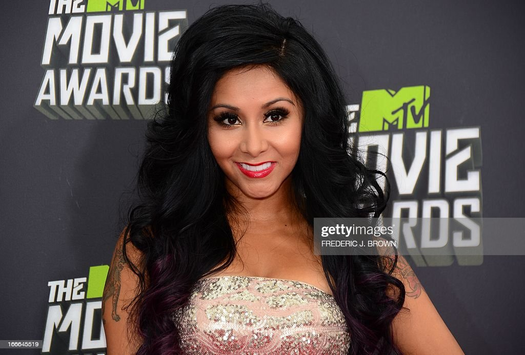 Television personality Snooki poses on arrival for the 2013 MTV Movie Awards in Los Angeles, California, on April 14, 2013. AFP PHOTO/Frederic J. BROWN
