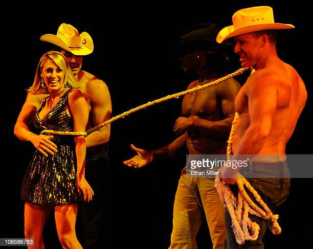 Television personality Vienna Girardi appears onstage with Chippendales dancers Juan DeAngelo Chaun Thomas Williams and James WIlcox as Girardi hosts...
