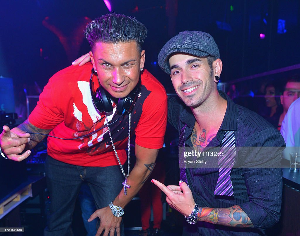 Television personality/DJ Paul 'Pauly D' DelVecchio (L) and DJ Shift appear at Haze Nightclub at the Aria Resort & Casino at City Center in celebration of DelVecchio's 33rd birthday on July 6, 2013 in Las Vegas, Nevada.