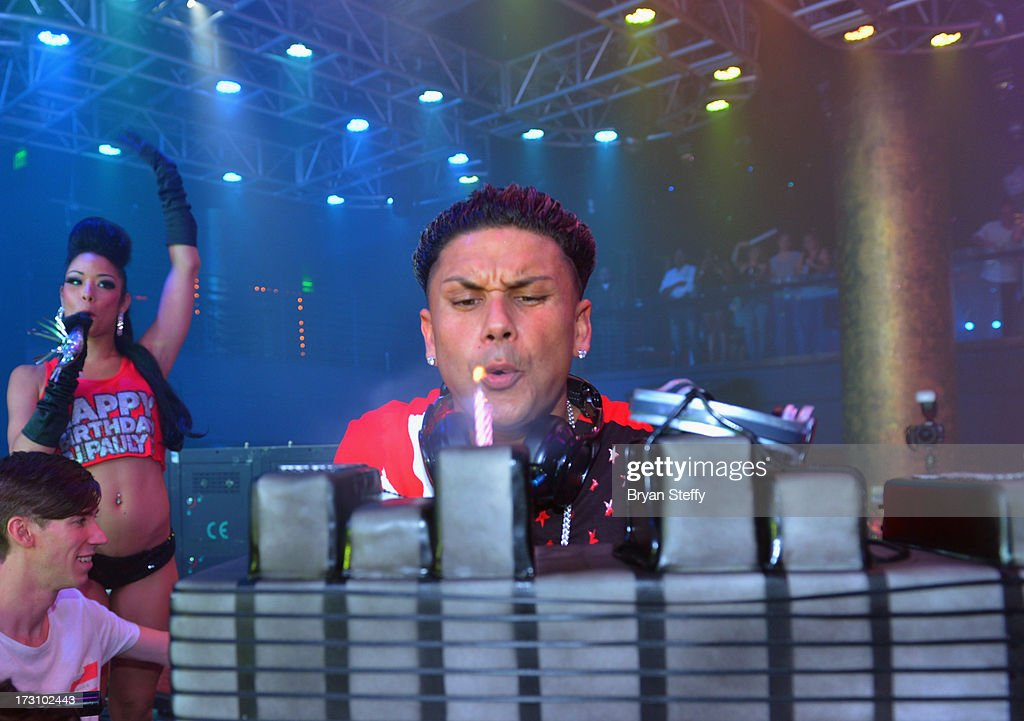 Television personality/DJ Paul 'Pauly D' DelVecchio blows out the candles on his birthday cake at Haze Nightclub at the Aria Resort & Casino at City Center on July 6, 2013 in Las Vegas, Nevada.