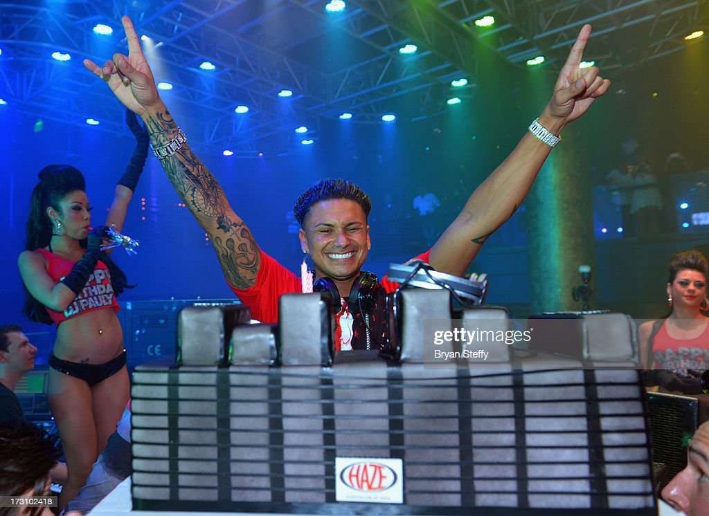 Television personality/DJ Paul 'Pauly D' DelVecchio poses with his birthday cake at Haze Nightclub at the Aria Resort & Casino at City Center on July 6, 2013 in Las Vegas, Nevada.