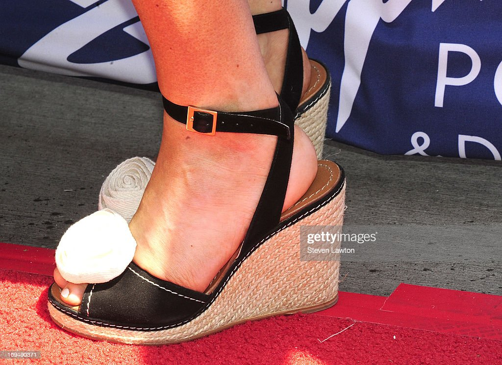 Television personality/model Crystal Hefner (shoes detail) arrives at the Sapphire Pool & Day Club during Memorial Day weekend on May 25, 2013 in Las Vegas, Nevada.