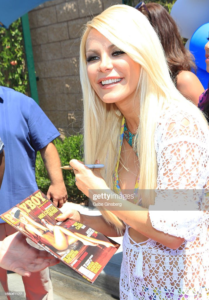 Television personality/model Crystal Hefner signs a Playboy at the Sapphire Pool & Day Club grand opening party on May 4, 2013 in Las Vegas, Nevada.