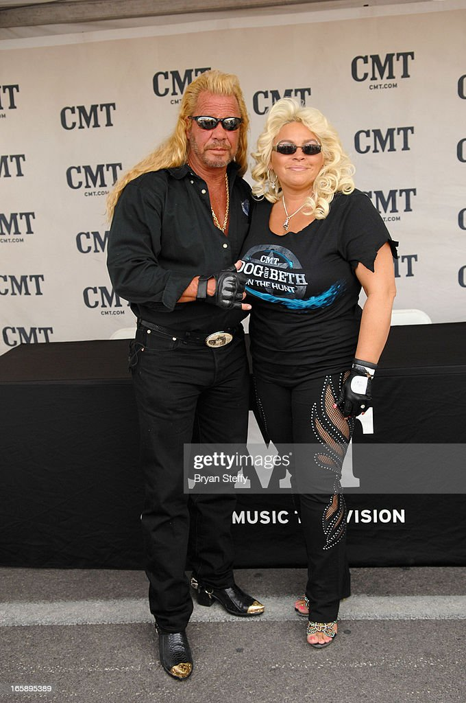 Television personality's Duane 'Dog' Chapman (L) and Beth Chapman appear during the 48th Annual Academy Of Country Music Awards Experience at the Orleans Arena on April 6, 2013 in Las Vegas, Nevada.