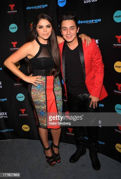 Television personalty Yarel Ramos and singer/songwriter Kevin Ortiz arrive at Telemundo and mun2's final 2013 Descarga concert at the Fremont Street...