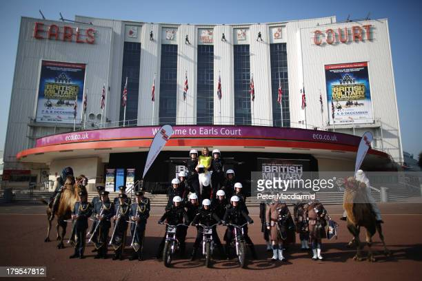 Television presenter Alex Jones poses with members of The Royal Signal's White Helmets display team after performing a stunt for The British Military...