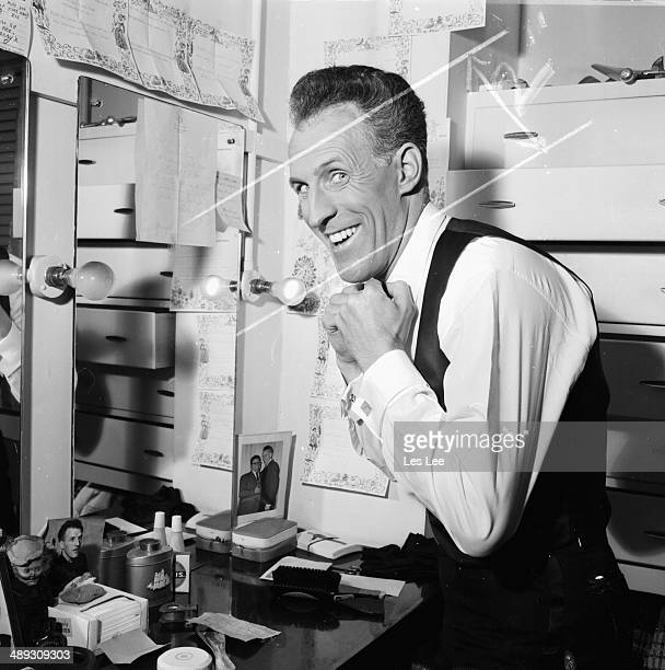 Television presenter and entertainer Bruce Forsyth getting ready in his dressing room London April 21st 1964
