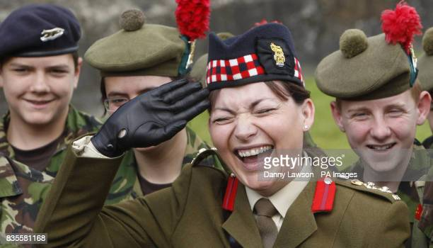 Television presenter and honorary Black Watch colonel Lorraine Kelly laughs as she inspects officer duties at the Royal Gun salute to mark the...