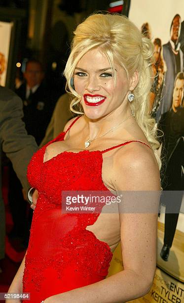 Television presenter Anna Nicole Smith walks on the red carpet during MGM's premiere of 'Be Cool' at Grauman's Chinese Theatre on February 14 2005 in...